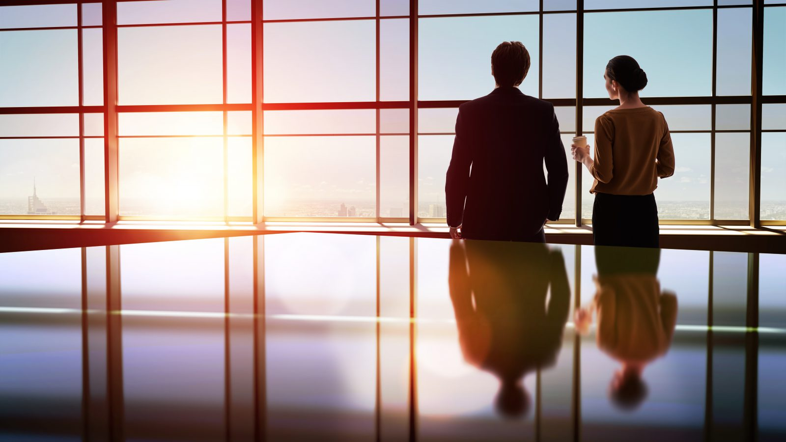 business people overlooking a city