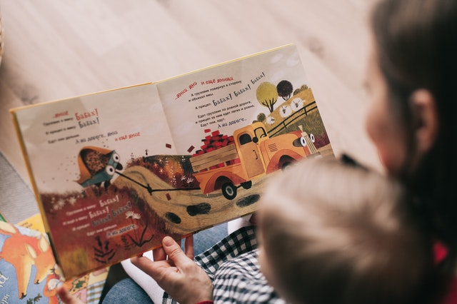 Lady reading child story
